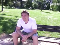 Handsome young guy undresses outdoors for money
