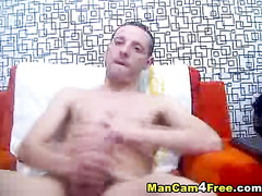 Skinny hunk is masturbating on hot gay porn