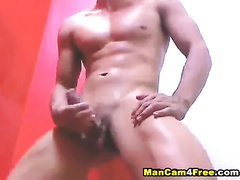 Exciting sexy shaped twink is hotly wanking off and posing