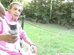 Young gay masturbating his cock outdoor